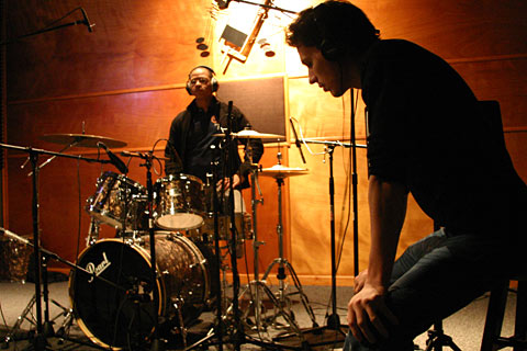 Andres and Cro Cro prep for the recording.